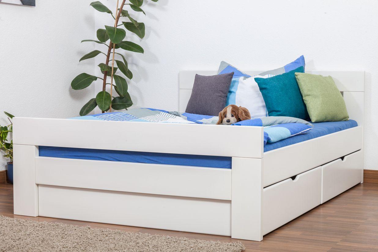 """Einzelbett / Funktionsbett """"Easy Premium Line"""" K6 inkl. 2 Schubladen und 1 Abdeckblende 140 x 200 cm Buche Vollholz massiv weiß lackiert"""